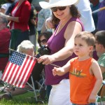 Georgianna Tata and her son Jack, 2, of Prospect enjoy the Memorial Day parade in Prospect in 2009. This year's event promises to be an equally meaningful day for veterans and town residents.