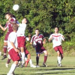 Tiago Martins (No .7) battles for a header as Nolan Kinne (No. 10) and Ruben Ferreira (No. 17) look on.