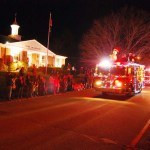 Beacon Hose Company's rescue truck passes in front of the Town Hall.