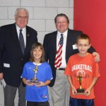 Shannon Burns, 9, in blue shirt, placed second with a total of 11 baskets made at the state Elks Hoop Shoot final on Feb. 12.