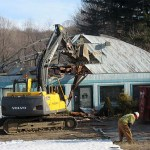 Workers demolish a building at 1198 New Haven Road in accordance with a notice from the Building Department. Snow on the roof of this vacant building in Naugatuck caused the roof to collapse Jan. 20.