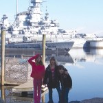 Girls Scouts from Troop 64570 of Naugatuck recently visited Battleship Cove in Fall River, Mass. From left, Girls Scouts Taylor Hopkins, Teagan Hopkins and Lindsey Schulte take time out during a recent trip to Battleship Cove in Massachusetts to pose for a picture. CONTRIBUTED