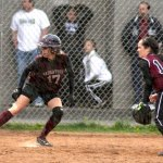 Naugatuck's Melissa LaBonte, 17, awaits a chance to come home as rain falls Monday versus Torrington. LaBonte slammed a triple in the first inning and scored one of the 'Hounds 3 runs on the day. PHOTO BY LARAINE WESCHLER
