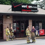 Naugatuck firefighters exit the Verizon Wireless store on New Haven Road after clearing the building Monday evening.