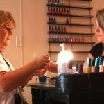Kim Perez, left, owner of New You Salon in Beacon Falls, buffs employee and Prospect pesident Korin DeVit's nails. Some services, like manicures, are no longer exempt from the state's sale tax. LARAINE WESCHLER