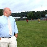 Naugatuck High School Athletic Director Tom Pompei looks over the soccer fields at the high school in late August during a tour of the building and grounds to review items in need of repair. The plan to renovate the high school as new includes building a multi-use, synthetic turf field. - LARAINE WESCHLER