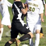 Woodland senior Matt Moutinho, left, notched five goals and had eight assists this season for the Hawks as his father, head coach Tony Moutinho, guided Woodland to the program's first Naugatuck Valley League championship and an undefeated regular season. RA ARCHIVE
