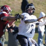 Naugatuck's Nico Cari puts the pressure on Ansonia quarterback Elliot Chudwick. RA ARCHIVE