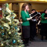 "From Left, members of ""Ques"" Adrienne Lisko, Charley Marenghi, David Santamauro, Lisa D'Andrea sing holiday tunes during United Way of Naugatuck and Beacon Falls' 5th Annual Festival of Trees at Naugatuck Savings Bank Dec. 2."