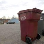 New trash and recycling containers sit at the end of Caitlin Circle in Naugatuck Friday afternoon. The town has provided the neighborhood new containers to address an ongoing issue over trash collection on the private street. RA ARCHIVE