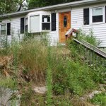 This unoccupied property at 714 Maple Hill Road was overgrown last summer. The borough has since taken steps to remediate the property.