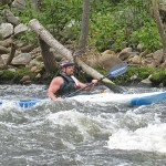 Tim Ward of Seymour approaches the finish line during the 4th annual Naugatuck Valley River Race last May.  The duck race, which usually takes place in October, will join the canoe and kayak race on May 5 this year. -FILE PHOTO