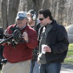 Prospect resident Brian Trent, right, looks at the shot director of photography Bill Hamell is getting during Selene Hollow's first day of shooting April 6 in Northfield.