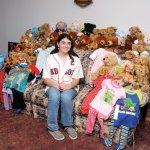 Boston Red Sox Kid Nation Captain Karissa Wilkinson of Beacon Falls shows the teddy bears and pajamas she collected for children at Yale-New Haven Hospital. Wilkinson collected a total of 55 teddy bears and 29 pairs of pajamas. -LUKE MARSHALL