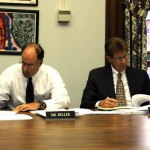 Board of Education Chair David Heller, left, and Superintendent of Schools John Tindall-Gibson review documents regarding the financial impact of closing Central Avenue School and Prospect Street School during a special meeting Wednesday night. The board voted, 7-2, to close the schools. –LUKE MARSHALL
