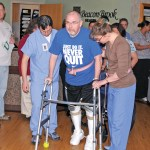 Naugatuck resident Bill Shannon, who was paralyzed in a fall in 2011, walks out of the Beacon Brook Health Center April 3. -LUKE MARSHALL