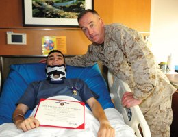 Lance Cpl. Roger Rua of the U.S. Marine Corps, pictured with General Joseph F. Dunford, ACMC, recently received the Purple Heart award. Rua, a Naugatuck resident, was injured March 29 from an improvised explosive device, which exploded under the vehicle he was riding in, while serving in Afghanistan. Rua sustained multiple injuries to his neck, back, and right leg. He is recovering right now at the VA Medical Center in Massachusetts. For is service, Rua has also been awarded the Afghanistan Campaign Medal, Combat Action Ribbon, and ISAF NATO Medal. –CONTRIBUTED