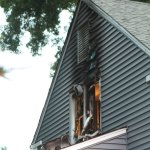A fire burned through a second-story bedroom window at 48 Moore Ave. in Naugatuck Sunday evening. -RA ARCHIVE