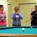 Jessica Rodriguez of Naugatuck, center, shares a laugh with Martha Espin, left of Naugatuck and volunteer Sheyen Cruz of Florida during a game of pool at the Naugatuck Senior Center July 20. –ELIO GUGLIOTTI