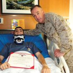 Lance Cpl. Roger Rua of the U.S. Marine Corps (left) poses for a picture with General Joseph F. Dunford, ACMC, after receiving the Purple Heart award earlier this year. Rua, a Naugatuck resident, was injured March 29 from an improvised explosive device, which exploded under the vehicle he was in, while serving in Afghanistan. Rua sustained multiple injuries to his neck, back, and right leg. Rua's family is holding a fundraiser Sunday at the Waterbury Portuguese Sport Club to help pay to make house and car handicap accessible if need be. –CONTRIBUTED