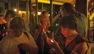 Janice Smolinski, right, of Cheshire, shields a lighted candle during the annual 'Night of Hope' vigil in 2011 in Naugatuck. The event is held to help raise awareness for missing people throughout the United States. This year's vigil will be held Sunday on the Town Green. The Smolinkski's son, Billy, went missing August 24, 2004 and to this date, has not been found. –RA ARCHIVE