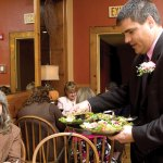Naugatuck Mayor Robert Mezzo, right, serves Janet Hall during the Waiters Go Pink fundraiser at Jesse Camilles Restaurant last October. This year's event, which raises money for breast cancer research as part of Griffin Hospital's annual Valley Goes Pink campaign, will be held Oct. 25. -FILE PHOTO