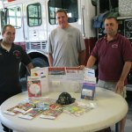 From left, Beacon Hose Company No. 1 members John Weid, Mike McGee and Fire Capt. James P. Trzaski, fire prevention committee chairman, pose next to a host of items that will either be featured or handed out to members of the community during National Fire Prevention Week. Beacon Hose will have an open house Oct. 10. It also will have an open house for senior citizens on Oct. 12. –RA ARCHIVE
