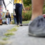 Students from Naugatuck High School walk down Rubber Avenue after leaving school Thursday afternoon in Naugatuck. The school board's policy committee is looking into the district's dress code policy. -RA ARCHIVE