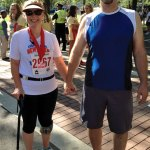 Tanya and Rick Sage, of Prospect, at the finish line of the New Haven 5K on Labor Day. Tanya, who defeated cervical cancer and is disabled and legally blind from a major car accident, began participating in triathlons and 5K races last year. –CONTRIBUTED