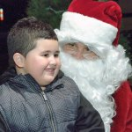 Brandon Rivera shares his Christmas wish list with Santa Claus last year during Naugatuck's holiday kickoff on the Town Green. This year's event will be held Monday from 5:30 to 8 p.m. on the Green. –FILE PHOTO