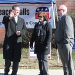 Republican Len Greene Jr., left, waves to a voter driving into Laurel Ledge Elementary School in Beacon Falls Tuesday afternoon. By his side are his mother, Robin Andrews, and his uncle, Joseph Pinto. Greene lost a close race for the 105th House District to Democrat Theresa Conroy. The race fell four votes shy of an automatic recount, according to Greene. –ELIO GUGLIOTTI
