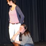 Helena, played by Catherine Pelkey, clings to the leg of Demetrius, played by Lily Fontaine, during a rehearsal of 'A Midsummer Night's Dream' on Monday at Woodland Regional High School. Woodland Theatre is presenting the play Dec. 7 and Dec. 8. –LUKE MARSHALL.