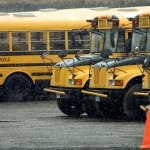 School buses sit parked at a Student Transportation of America lot on South Main Street in Naugatuck Tuesday. The company was fined by the EPA for letting the buses idle too long. –RA ARCHIVE