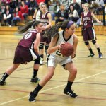 Woodland's Andrea Piccolo (22) makes a move to the basket last Friday night versus Naugatuck in Beacon Falls. The Greyhounds won the game, 41-35. –ELIO GUGLIOTTI