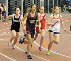 Naugatuck High School's Heyi Cheng leads the way in the 4-by-800 Tuesday at the Naugatuck Valley League indoor track championships in New Haven. The Naugatuck girls team came in third at the meet. –LUKE MARSHALL