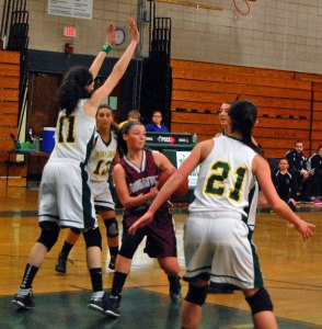Naugatuck's Angelina Piccirillo looks for an open teammate Feb. 1 versus Holy Cross in Waterbury. The Greyhounds lost the game, 51-43, but bounced back with a 46-21 win over Sacred Heart Tuesday night to clinch a spot in the state tournament. –KEN MORSE
