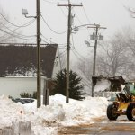 A payloader works to clear snow from Center Street in Prospect Feb. 11.-RA ARCHIVE