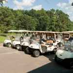 Golfers head out to the course at Hop Brook Golf Course in Naugatuck last summer after picking up their golf cart. The borough will begin replacing the carts this year. –RA ARCHIVE