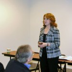 Liz Falzone, left, and Rick Cherhoniak, members of Citizen's for Tomorrow's Downtown, address the audience during the Beacon Falls Business and Economic Development Forum 'State of the Town' at Kolga LLC in the Pinesbridge Commerce Park Tuesday morning. –LUKE MARSHALL