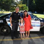 Western Elementary School Principal Melissa Cooney, right, poses for a picture with Tara Fitzgerald, who won a ride to school in a police cruiser, and Naugatuck Police Det. Sean Simpson on the first day of school in August. Cooney will be leaving Western School to become principal at Cross Street Intermediate School at the end of the school year. –FILE PHOTO