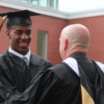 Woodland graduate Rahmi Rountree shakes hands with Brian Fell, assistant principal and athletic director, after receiving his diploma Monday night during graduation at the school in Beacon Falls. –ELIO GUGLIOTTI