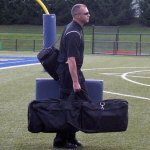 Woodland athletic trainer Ray Donaghy carries his equipment during a football game at Municipal Stadium in Waterbury in 2009. Donaghy has retired as the school's athletic trainer but will remain as a physical education teacher. –KYLE BRENNAN