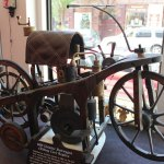 A replica of an 1885 Daimler Reitwagon (riding car) built by William Eggers of Goshen is on display at Hawkins Galleries on Church Street. –ELIO GUGLIOTTI