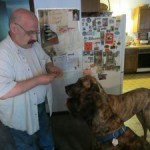 Rocky Vitale feeds treats to Tank and Moose, his Great Danes at his home last week. After two years of inaction, Vitale is resuscitating the plan to build a dog park in the borough. –RA ARCHIVE