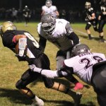 Naugatuck linebacker Jour'dan Hopkins (7), defensive back Maleek Brooks (28) and the Greyhounds' defense have given up an average of 16.3 points per game. The defense will look to shutdown Ansonia running back Arkeel Newsome on Thanksgiving. –ELIO GUGLIOTTI