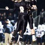 Woodland's Jonathan Scirpo (8) celebrates with Coby Vaccarelli (25) Tuesday night in Beacon Falls after a touchdown. The Hawks defeated Morgan, 47-21, to advance to Saturday's Class S semifinals. –RA ARCHIVE