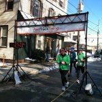 Racers cross the finish line during last year's St. Patrick's Day Road Race in Naugatuck. The race has been renamed the ion Bank St. Patrick's Day Road Race and Festival this year and will feature a 10K run for the first time. –FILE PHOTO