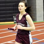 Naugatuck's Emily Pohorilak races Jan. 28 during the 4-by-800-meter relay at the NVL indoor boys and girls track championships at the Floyd Little Athletic Center at Hillhouse High School in New Haven. The Naugatuck girls finished fifth at the meet. –LUKE MARSHALL