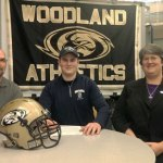 Woodland senior Alik Bures, center, signed his National Letter of Intent Monday night to play football at Southern Connecticut State University. The 6-foot-7, 297-pounder started at left tackle for the Hawks, who were the Class S and Naugatuck Valley League runners-up in 2013. 'I really like the campus, the facilities and the coaching staff,' Bures said. 'As long as I work hard, I know I can go far.' Bures' parents, Craig and Kristin, joined him for the signing. His older brother, Ian, plays football at Plymouth State in New Hampshire. –KYLE BRENNAN