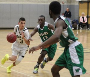 Woodland's Jack Pinho (3) is one of seven seniors who played their last game on the hardwood for the Hawks March 10 in the Class M state tournament. Head coach Ton Hunt lauded the group for continuing to improve the program's status. –FILE PHOTO